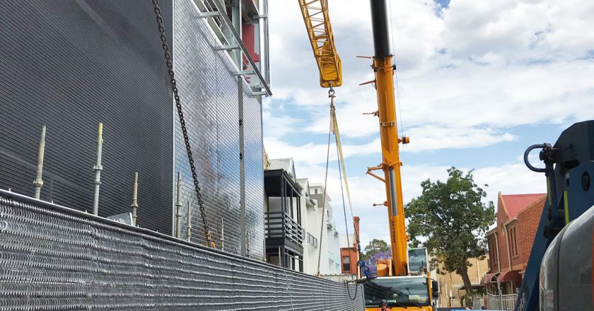 How the firm undertook its award-winning lift and install of a curtain facade in Adelaide.