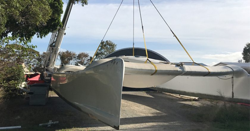 A pair of mobile cranes in the Gold Coast have transported one of the fastest speedboats in Australia from a holding yard at Stieglitz Wharf in Jacobs Wells