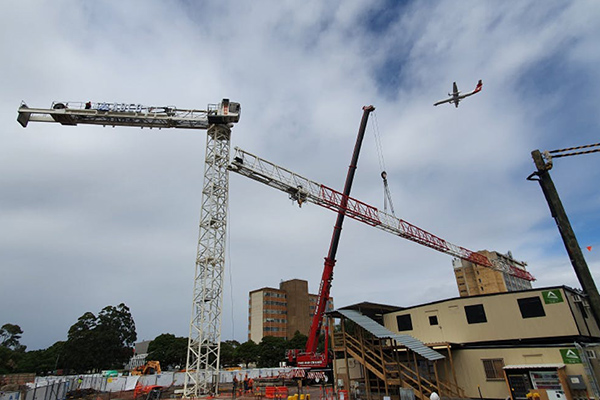 A tower crane has been installed at the site of the $90 million Qantas Group Flight Training Centre, where construction has ramped up.