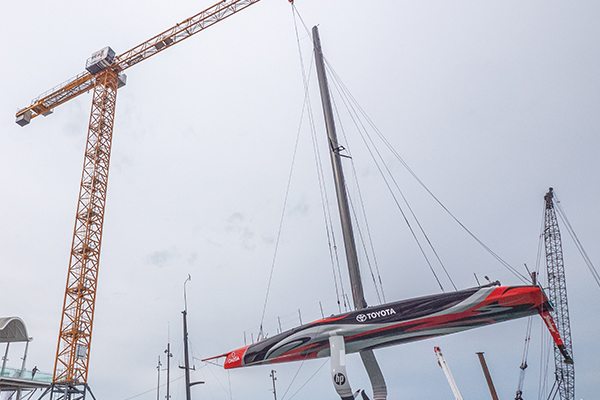 A Liebherr 285 EC-B Tower Crane has been entrusted with the delicate role of lifting Team New Zealand's prized race boat in and out of its harbour base. Cranes and Lifting explains.