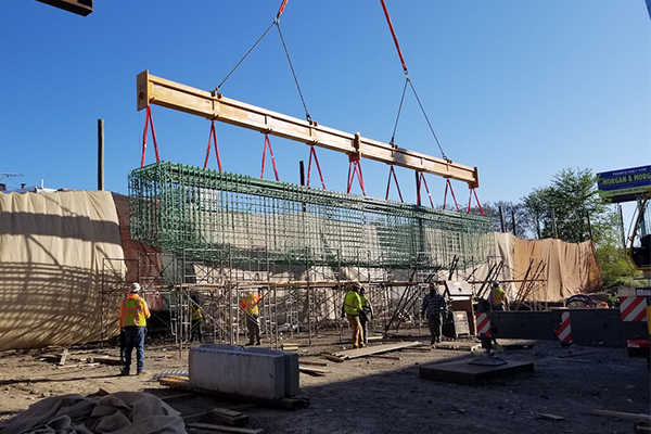 A 250t Grove mobile crane is using a custom 23-metre long, 23t capacity beam for lifting 60 rebar cages on a highway project in Philadelphia, Pennsylvania.
