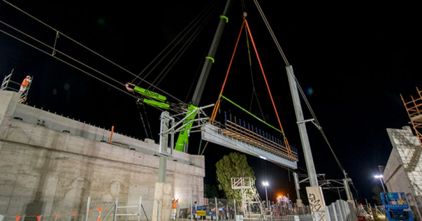 Construction crews have worked around the clock at the Evans Road level crossing in Lyndhurst, Melbourne, to install seven massive bridge beams.