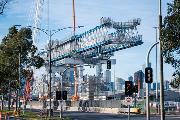 A giant launching gantry crane has been erected to help build a new elevated road at Footscray Road as part of the West Gate Tunnel Project.